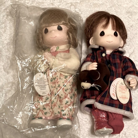 Pair Of Precious Moments Dolls